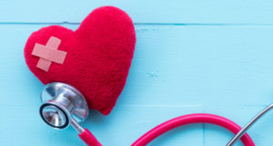 Stethoscope checking a broken heart