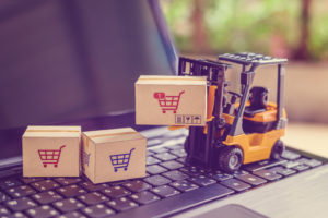 Forklift on a keyboard moving delivery boxes
